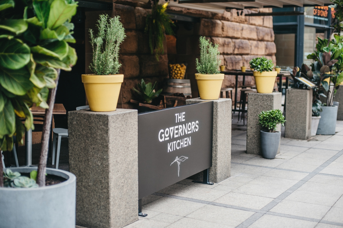 Exterior of cafe with seating and planter boxes.