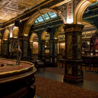 Interior image showing the elaborate stonework and paneling of the Marble Bar