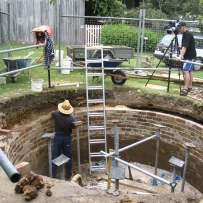 Underground brick water tank or cistern with domed roof being demolished and reconstructed.
