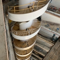 Looking down onto spiral stairs.