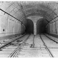 Double tunnel with tracks leading into darkness.
