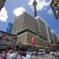 City street with multistory building in the background including Centrepoint Tower.