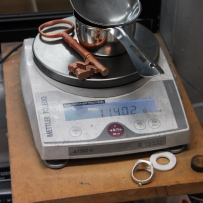 Bronze key on electronic scales.