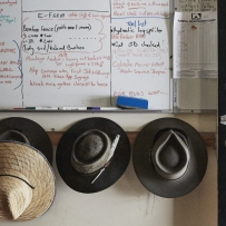 whiteboard and hat rack for the gardeners