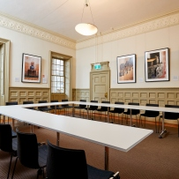 High ceilinged room set up for meeting.