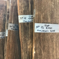 Selection of timber slabs with labels.