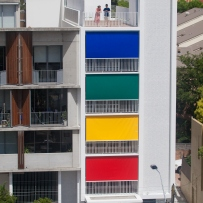 Exterior photograph looking down at the colorful facade of Studios 54 from Waterloo Street.