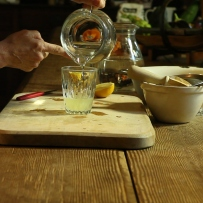 Sugar water being poured into glass jug.