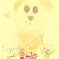 A child's drawing of a brown teddy bear with love hearts