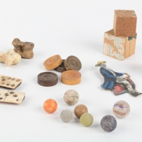 Games and toys including wooden blocks, dominoes, marbles, chalk, draughts, cardboard doll, doll's teacup and bones