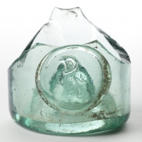Fragment of heavy bottomed glass bottle with arrow mark.