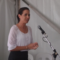 Woman at microphone.