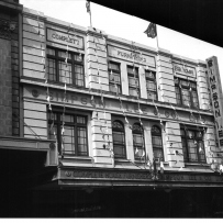 Black and white image of department store building.