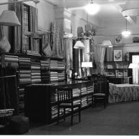Black and white image of interior of department store building.