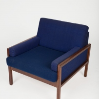 Easy chair with blue wool upholstery and wooden frame