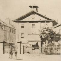 B/W drawing of Hyde Park Barracks, viewed across Queens Square, showing pedestrians and office workers in front of the large old 3 storey building with gable front and large sandstone wall, trees and gate area in the foreground.