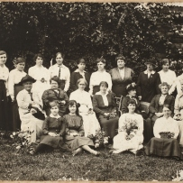 Black and white illustration of group of women seated and standing in outdoor setting.
