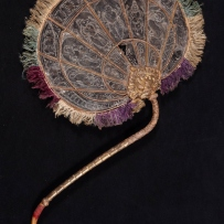 Blade fan with sinuous cane handle. Burma (Myanmar), late 19th century.