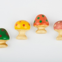 Small mushroom magnets in varied colours with spots.