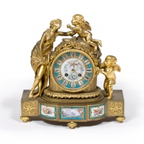 Ornate gold sculpted clock.