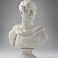 High 3/4 profile bust of man with moustache and sideburns, robed.