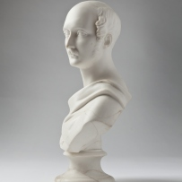 Bust of main in high 3/4 profile, with moustache and sideburns, robed.