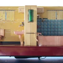 Model/sample of partitioned bathroom fitted with toilet, vanity, light and bath/shower, c.1950