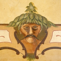 Foliate head painted decoration