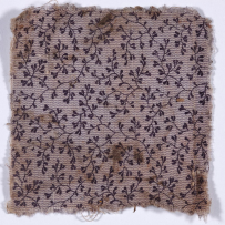 Purple textile fragment