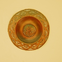 Closeup of ornately decorated doorbell.