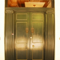 Set of painted doors with reflected light off paintwork.