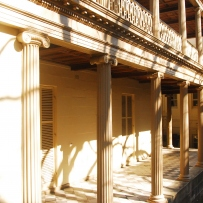 View of sunlit verandah and supporting columns.