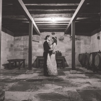 Couple in wine cellar.