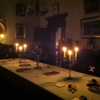 Nightlight tour by candlelight in darkened room.