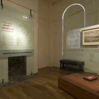 Documentation of Convicts: sites of punishment exhibition showing exhibition panel and fireplace