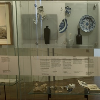 Documentation of Convicts: sites of punishment exhibition showing ceramics and glassware