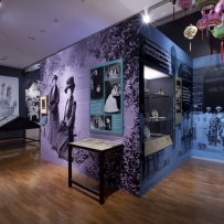 This is a photograph taken inside the exhibition Celestial City and shows large printed wall graphics and colourful lanterns