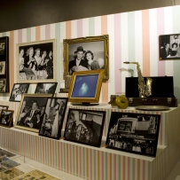 Interior of exhibition with displays cases and framed photographs.