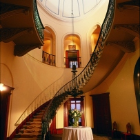 Image of foyer area with winding wooden staircase