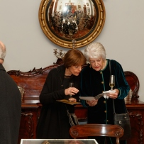 Margot Chinneck and Jennifer Fisher examine the program at the Bel Canto in the Bush recital