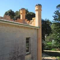 Exterior of turreted building.