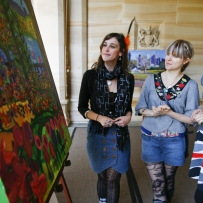 Studio ARTES paintings displayed on terrace of Government House during Garden Music