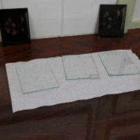 Glass plates on white cloth.