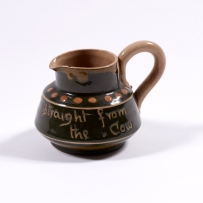 Brown glazed jug.
