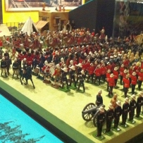 This is a photo of a display of toy soldiers, civilians and coaches