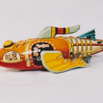 This is a photograph of a colourful tin rocket ship
