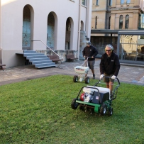 Horticulturist Stephen operated the corer on the buffalo lawn at The Mint