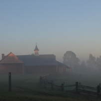 Sun over stables.