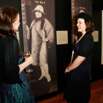 Visitors enjoy the Femme Fatale exhibition at the Justice & Police Museum