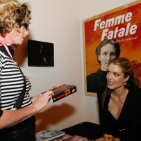 Tara Moss signing her book at the Femme Fatale exhibition launch